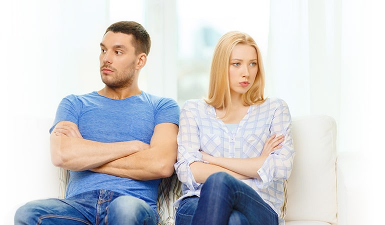 unhappy couple not speaking after having argument at home